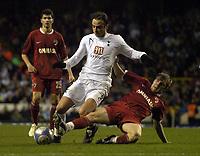 Photo: Olly Greenwood.<br />Tottenham Hotspur v Dinamo Bucuresti. UEFA Cup. 14/12/2006. Spurs Dimitar Berbatov tackled by Dinamo's Cosmin Moti