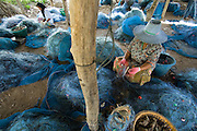 Mending fishing nets, Songkhla, Thailand