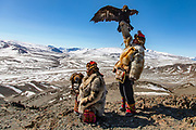 Eagle hunters in Mongolia with their golden eagle in the Altai mountains, Bayan Olgii, Mongolia
