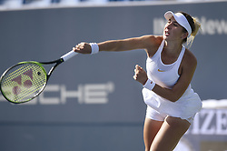 August 21, 2018 - New Haven, CT, USA - Belinda Bencic of Switzerland serves against Camila Giorgi of Italy during their second-round match at the Connecticut Open Tennis Tournament in New Haven, Conn., on Tuesday, Aug. 21, 2018. Bencic advanced, 6-4, 6-4. (Credit Image: © John Woike/TNS via ZUMA Wire)