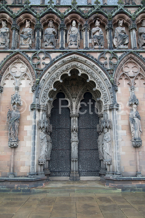 Intricate stone carvings of Saints and Kings on the exterior of Lichfield Cathdral in Lichfield, England, United Kingdom. Lichfield Cathedral is situated in Lichfield, Staffordshire. It is the only medieval English cathedral with three spires. The Diocese of Lichfield covers all of Staffordshire, much of Shropshire and part of the Black Country and West Midlands.