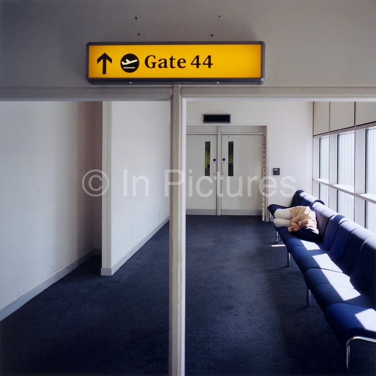 A lone sleeping passenger rests on a bench in an otherwise peaceful corner of Gatwick airport in England. Having chosen a quiet location in the terminal, near  departure number gate 44, there is enough space to stretch out and grab some valuable sleep. Jet lag, medically referred to as desynchronosis, is a physiological condition which results from alterations to the body's circadian rhythms resulting from rapid long-distance transmeridian (east–west or west–east) travel on a (typically jet) aircraft. It was previously classified as one of the circadian rhythm sleep disorders.