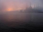 Sunrise through the fog over Battersea Power Station, London