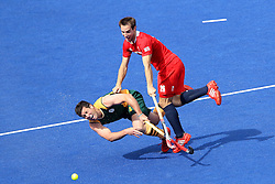 Lloyd Madsen of South Africa is tackled by Nicholas Caitlin of Great Britain during the men's hockey match between South Africa and Great Britain held at the Riverbank Arena at Olympic Park in London as part of the London 2012 Olympics on the 1st August 2012..Photo by Ron Gaunt/SPORTZPICS