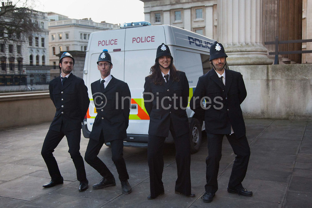 Performers dressed as police pose in front of a police van at the museum. BP or not BP, a political performance group stage another one of their theatrical performances at the British Museum to highlight the fact that the Museum is sponsorer by BP, one of the world biggest oil producing companies and responsoble for numerous oils spills, including the biggest one in history, the Horizon oil disaster in the Mexican gulf.
