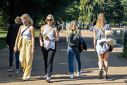 Licensed to London News Pictures. 16/09/2021. London, UK. Walkers enjoy the late summer sun in Hyde Park, London as weather forcasters predict a warmer few days ahead with highs of 24c for London and the South East. Photo credit: Alex Lentati/LNP