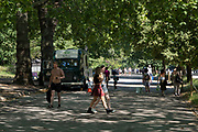 Hyde Park is full of people out enjoying the summer sunshine and incredibly hot temperatures under Coronavirus lockdown on 25th June 2020 in London, England, United Kingdom. As the July deadline approaces and government will relax its lockdown rules further, the West End remains quiet, while some non-essential shops are allowed to open with individual shops setting up social distancing systems.
