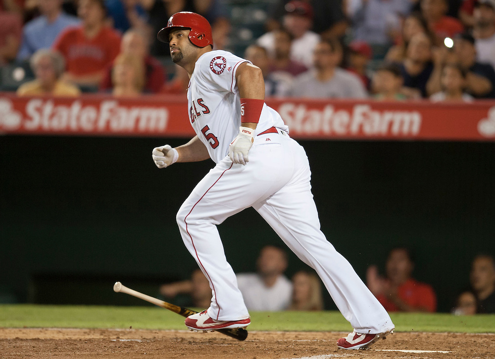 The Angels' Albert Pujols watches his first three-run home run of the game in the fourth inning against the Texas Rangers at Angel Stadium on Tuesday.<br /> <br /> ///ADDITIONAL INFO:   <br /> <br /> angels.0720.kjs  ---  Photo by KEVIN SULLIVAN / Orange County Register  -- 7/19/16<br /> <br /> The Los Angeles Angels take on the Texas Rangers at Angel Stadium.
