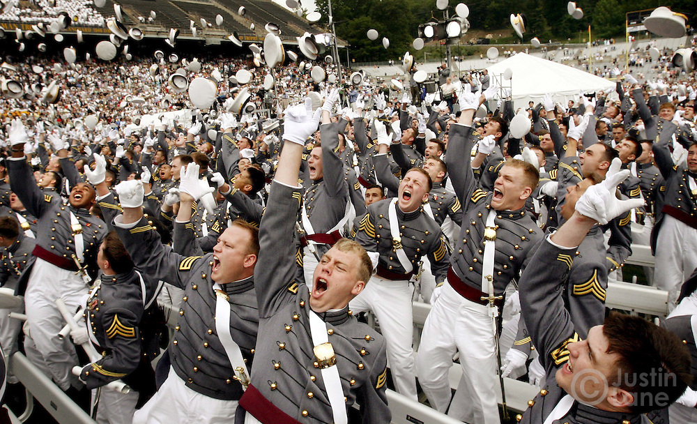 epa00724290 West Point Military Academy cadets throw their hats in the air and celebrate after being dismissed at the end graduation ceremonies in West Point , New York on Saturday 27 May 2006. United States President George W. Bush delivered the commencement address.  EPA/JUSTIN LANE