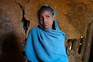 Young ethiopian girl from the  highlands. Travel portraits by Lorenz Berna