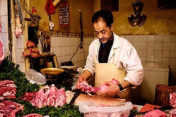 A butcher at work in his shop in the medina in Marrakech, Morocco, North Africa<br /> <br /> (c) Andrew Wilson | Edinburgh Elite media