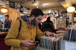 © Licensed to London News Pictures. 16/04/2016. London, UK. Fans of vinyl visit record shops in and around Berwick Street in Soho today, on Record Store Day, a worldwide celebration of analogue music and music to be listened to from a physical format. Photo credit : Stephen Chung/LNP