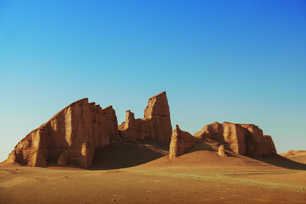 These peculiar shaped pillars have been generated by the extreme soil and water erosion over thousands of years in Dasht-e Loot Desert (Lut desert), South of Iran. It was inscribed to the UNESCO World Heritage Sites in 2016 and is one of the driest and hottest places on Earth.