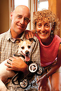 "Oak Creek, Colorado, USA -<br /> Kandu - the little dog that could<br /> <br /> Kandu was born without front legs. His original owners, fearing the Jack Russell terrier would never have a normal life, left him at a local shelter to be euthanized.<br /> <br /> Ken Rogers and his wife, Melissa, were watching the news one night at their home near Steamboat Springs, Colorado when they saw a segment on Kandu which melted their hearts.<br /> <br /> They immediately applied to adopt him - along with 99 other families.<br /> <br /> When Ken and Melissa brought Kandu home, Ken got right to work on a contraption made of molded plastic and rollerblade wheels so Kandu could get around.<br /> <br /> ""Now he can run with the other dogs,"" says Ken, who even designed a mono-ski for Kandu so he can play in the snow.<br /> <br /> ""He doesn't think he's handicapped,"" says Ken. ""He's got such spirit.""<br /> <br /> Meanwhile, Melissa has been visiting nearby Yampa Valley Medical Center with Kandu to lift patients' spirits. When it is time for his ""shift,"" Kandu runs towards the hospital doors. ""He's pure joy,"" says Melissa.<br /> <br /> Patients who are struggling to recover from strokes, accidents, serious illness or operations react when they see Kandu scampering around. Perhaps they think ""If Kandu can do it, maybe I can too.""<br /> <br /> Kandu has been so successful at getting around on just two legs that Ken and Melissa have adopted a playmate for him - Luci - a Chihuahua which was also born without any front legs. <br /> (Credit Image: © John F. Russell/Exclusivepix)"