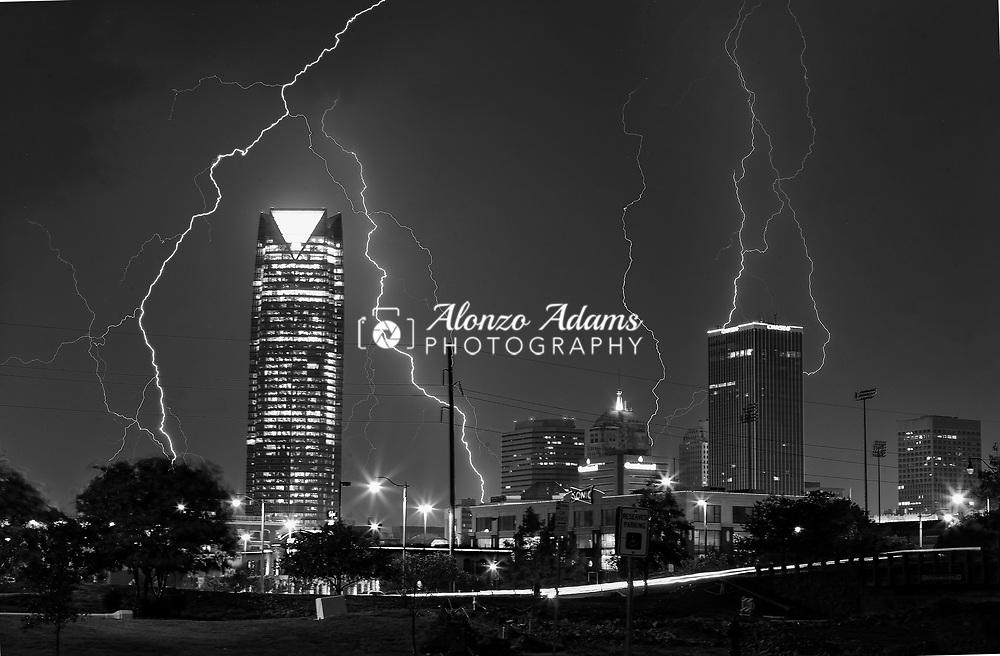 Lightning strikes around downtown buildings on September 26, 2012. Photo copyright © 2012 Alonzo J. Adams.