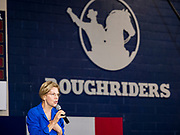 """21 OCTOBER 2019 - DES MOINES, IOWA: US Senator ELIZABETH WARREN (D-MA) talks to about 500 students during an assembly at Roosevelt High School in Des Moines. The school's athletic teams are called the """"Roughriders"""" after Teddy Roosevelt's Roughriders of the Spanish-American War. Sen. Warren talked to students about her journey from childhood in Oklohoma to running for the US Presidency. Sen. Warren is campaigning to be the Democratic nominee for the US presidency in Iowa this week. Iowa traditionally hosts the the first selection event of the presidential election cycle. The Iowa Caucuses will be on Feb. 3, 2020.                 PHOTO BY JACK KURTZ"""