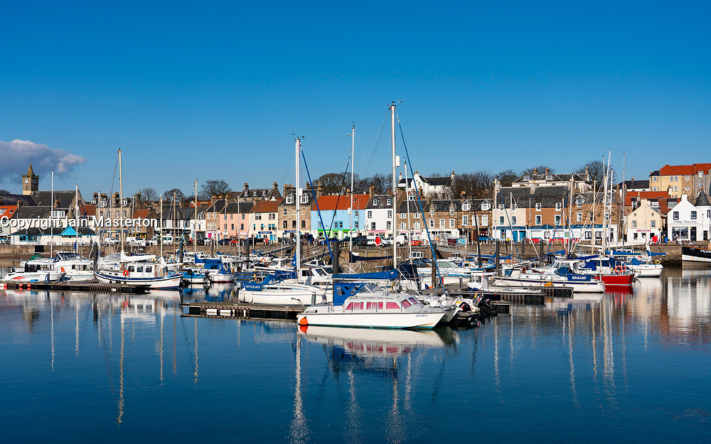 Waterfront and sailing boats in harbour at Anstruther fishing village in East Neuk of Fife, Scotland, UK