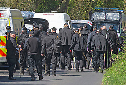 © Licensed to London News Pictures 30/04/2021. Snowdown, UK. A large number of police officers have a briefing before going off to search. Police continue to search fields and woodland in the village of Snowdown in Kent after the murder of PCSO Julia James age 53 on Tuesday. The body of PCSO James was found on the edge of Ackholt Woods on the outskirts of the village. A post-mortem has taken place and can confirm serious head injuries. Photo credit:Grant Falvey/LNP