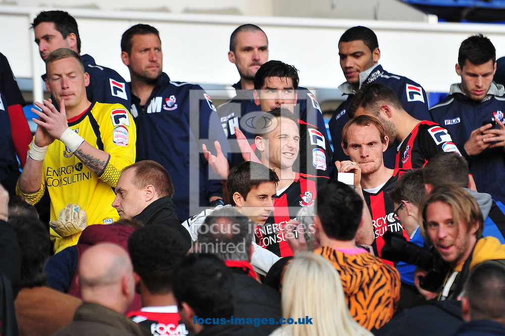 Picture by Ste Jones/Focus Images Ltd +44 7706 592282.27/04/2013.After learning of the other crucial fixture in League 1, The dejected Bournemouth players appear in the directors box to salute their fans on the pitch during the npower League 1 match at Prenton Park, Birkenhead.