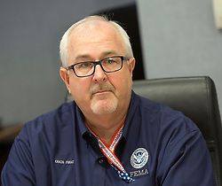 Federal Emergency Management Agency(FEMA) Administrator Craig Fugate listens after a briefing At FEMA Headquarters in Washington DC, October 5, 2016. Photo/ Chris Kleponis/Abaca