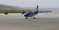 Barra Airport is a short-runway airport situated in the wide shallow bay of Traigh Mhòr at the north tip of the island of Barra in the Outer Hebrides, Scotland. Barra is now the only beach airport anywhere in the world to be for scheduled airline services. Loganair Twin Otter approaching terminal building. (c) Stephen Lawson   Edinburgh Elite media