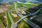 Nederland, Zeeland, Terneuzen, 09-05-2013; Zeeuws-Vlaanderen, Terneuzen. Westerscheldetunnelweg, N62, verbindt de zuidelijk ingang van de Westerscheldetunnel met het landelijke wegennet. Kruising met Herbert H. Dowweg (N252) .<br /> Landscape near Terneuzen (Zeeuws-Vlaanderen), the roadway to the tunnel in the Westerschelde between the agricultural fields.<br /> luchtfoto (toeslag op standard tarieven);<br /> aerial photo (additional fee required);<br /> copyright foto/photo Siebe Swart.