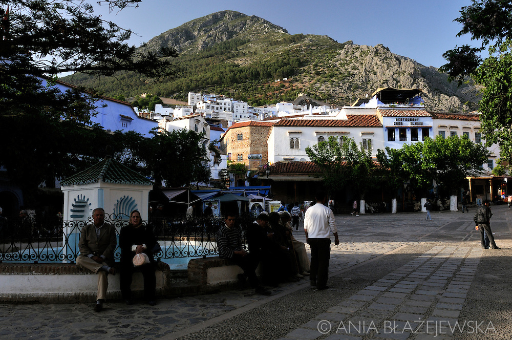 Morocco, Chefchaouen. People taking some evening rest in the Place el-Majzen, the main place in the old medina.