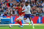 Strahil Popov of Bulgaria and Danny Rose of England battle for the ball during the UEFA European 2020 Qualifier match between England and Bulgaria at Wembley Stadium, London, England on 7 September 2019.
