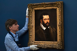 "© Licensed to London News Pictures. 29/06/2018. LONDON, UK. A staff member presents ""Portrait of a Venetian Nobleman"" by Sir Peter Paul Reubens (Est. £3-4m).  Preview of Old Masters, British, Treasures, Sculptures and Ancient works at Sotheby's New Bond Street to be offered for sale on 3 and 4 July 2018.  Photo credit: Stephen Chung/LNP"