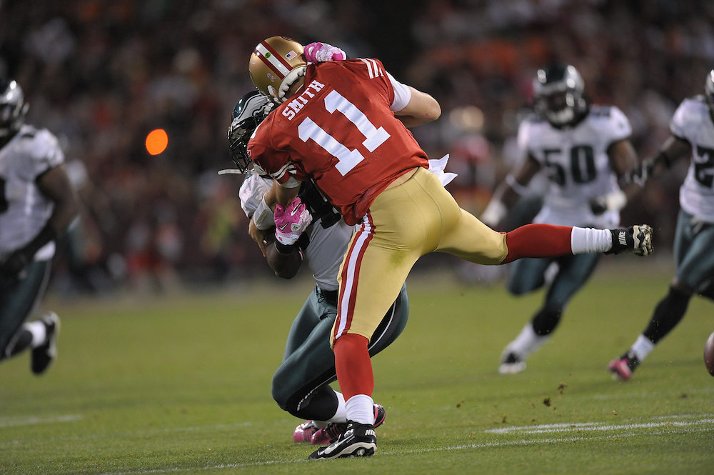 SAN FRANCISCO - OCTOBER 10: Quarterback Alex Smith #11 of the San Francisco 49ers is fumbles while being sacked by defensive end Brandon Graham #54 of the Philadelphia Eagles at Candlestick Park on October 10, 2010 in San Francisco, California. Safety Quintin Mikell #27 of the Philadelphia Eagles picked up the fumble and ran for a touchdown during the Eagles 27-24 victory. (Photo by Drew Hallowell/Getty Images)  *** Local Caption *** Alex Smith;Brandon Graham