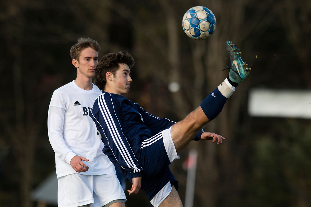 MMU's Asher Symanowicz (23) kicks the ball during the high school boys semifinal soccer game between the Burlington Seahorses and the Mount Mansfield Cougars at MMU High School on Tuesday afternoon October 29, 2019 in Jericho, Vermont. (BRIAN JENKINS/for the FREE PRESS)
