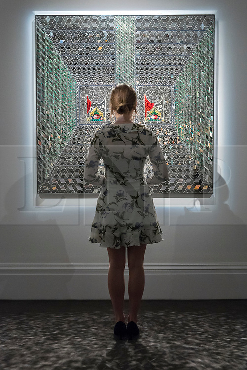 """© Licensed to London News Pictures. 20/04/2018. LONDON, UK. A staff member views """"Recollections I"""", 2008, by Monir Farmanfarmaian (Est. GBP160-200k) at a preview of works in Sotheby's 20th Century Middle East, Orientalist and Islamic upcoming art sales in New Bond Street.  The works will be sold at auction in the last week of April.    Photo credit: Stephen Chung/LNP"""