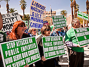 22 FEBRUARY 2011 - PHOENIX, AZ:  Sheri Van Horsen (CQ) left, a state employee, and Nancy Gray (CQ) right, President of the Phoenix AFSCME, demonstrate in support of Wisconsin workers and unions workers across the US at the State Capitol in Phoenix Tuesday. Hundreds of people including supporters of immigrants' rights, supporters of border defense, motorcycle riders and members of the Tea Party, converged on the capitol to express their views on bills.     PHOTO BY JACK KURTZ