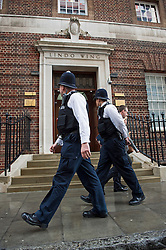 © London News Pictures. 25/04/2015. Police officers patrol outside the entrance to Lindo Wing of St Mary's hospital in Paddington. London, where The Duchess of Cambridge is due to give birth. Photo credit: Ben Cawthra/LNP
