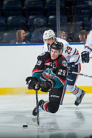 KELOWNA, CANADA - SEPTEMBER 5: Nolan Foote #29 of the Kelowna Rockets is tripped up by Justin Sigrist #29 of the Kamloops Blazers on September 5, 2017 at Prospera Place in Kelowna, British Columbia, Canada.  (Photo by Marissa Baecker/Shoot the Breeze)  *** Local Caption ***