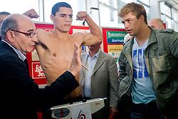 Argentina's challenger Rodolfo Ezequiel Martinez - Epi and Dirk Dzemski (R) at official weighing 1 Day before IBF World Champion title fight, on April 8, 2010, in Avto Delta, Ljubljana, Slovenia.  (Photo by Vid Ponikvar / Sportida)
