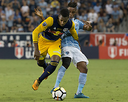 September 20, 2017 - Kansas City, Kansas, U.S - Sequence 01-04: Sporting KC forward Latif Blessing #9 (behind) maneuvers for a toe tackle against NY Red Bulls defender Michael Amir Murillo #62 (front) during the first half of the game. Sporting KC will win the 2017 Lamar Hunt Open Cup championship with a score of 2-1 over the New York Red Bulls. (Credit Image: © Serena S.Y. Hsu via ZUMA Wire)