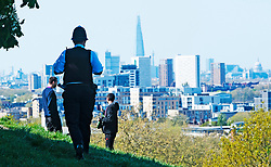 ©Licensed to London News Pictures 14/04/2020  <br /> Greenwich, UK. A police officer walking over to some young men to ask them to move on. Sunny weather in Greenwich park, Greenwich, London as people get out of the house from coronavirus lockdown to exercise. Photo credit:Grant Falvey/LNP