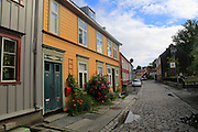 Historic Nygata street old housing in city centre Nedre Bakklandet area, Trondheim, Norway