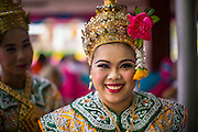 """29 SEPTEMBER 2012 - NAKORN NAYOK, THAILAND:   Thai dancers prepare to perform during observances of Ganesh Ustav at Wat Utthayan Ganesh, a temple dedicated to Ganesh in Nakorn Nayok, about three hours from Bangkok. Many Thai Buddhists incorporate Hindu elements, including worship of Ganesh into their spiritual life. Ganesha Chaturthi also known as Vinayaka Chaturthi, is the Hindu festival celebrated on the day of the re-birth of Lord Ganesha, the son of Shiva and Parvati. The festival, also known as Ganeshotsav (""""festival of Ganesha"""") is observed in the Hindu calendar month of Bhaadrapada, starting on the the fourth day of the waxing moon. The festival lasts for 10 days, ending on the fourteenth day of the waxing moon. Outside India, it is celebrated widely in Nepal and by Hindus in the United States, Canada, Mauritius, Singapore, Thailand, Cambodia, Burma , Fiji and Trinidad & Tobago.    PHOTO BY JACK KURTZ"""
