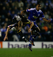 Photo: Steve Bond.<br /> Leicester City v Cardiff City. Coca Cola Championship. 26/11/2007. darren Purse (R) min mid air