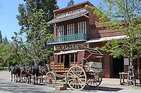 Stagecoach waiting outside the Wells Fargo depot, Main Street, Columbia, California, USA. Columbia is in fact Columbia State Historic Park where there is a real town built in the 1850's during the gold rush and where there still are 33 original buildings. 201304211754<br />