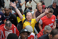 Arsenal fans celebrate their win after the final whistle as they leave Selhurst Park. Barclays Premier league match, Crystal Palace v Arsenal at  Selhurst Park in London on Sunday 16th August 2015.<br /> pic by John Patrick Fletcher, Andrew Orchard sports photography.