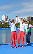 "Rio de Janeiro. BRAZIL.   2016 Olympic Rowing Regatta. Lagoa Stadium, Gold Medalist POL W2X: Bow Magdalena Fularczyk-Kozlowska,<br /> s Natalia Madaj, Celebrate,<br /> <br /> Copacabana,  ""Olympic Summer Games""<br /> Rodrigo de Freitas Lagoon, Lagoa.   Thursday  11/08/2016 <br /> <br /> [Mandatory Credit; Peter SPURRIER/Intersport Images]"