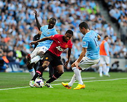 Manchester United's Luis Antonio Valencia takes on Manchester City's Aleksandar Kolarov - Photo mandatory by-line: Dougie Allward/JMP - Tel: Mobile: 07966 386802 22/09/2013 - SPORT - FOOTBALL - City of Manchester Stadium - Manchester - Manchester City V Manchester United - Barclays Premier League