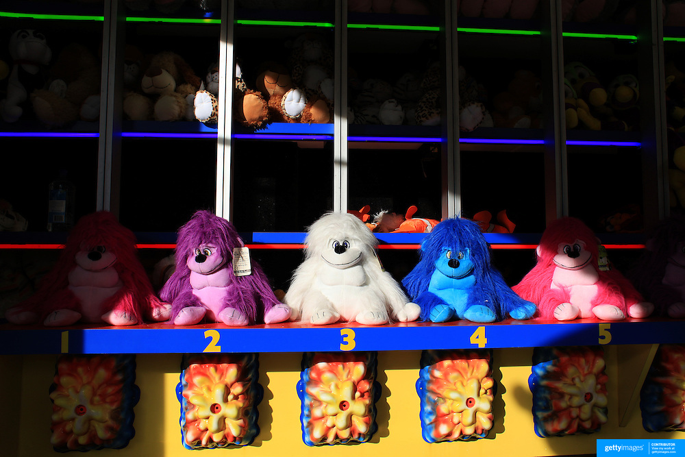 Cuddly toys on a fair ground game during the May Fair at Saint Mark's Church, New Canaan, Connecticut, USA. 12th May 2012. Photo Tim Clayton
