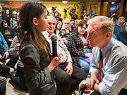 13 JANUARY 2020 - WEST DES MOINES, IOWA: TOM STEYER, right, takes a question from a child about climate change at a house party in West Des Moines Monday night. The main issue was climate change, which Steyer has said is his top priority. Steyer, a California businessman, is campaigning to be the Democratic nominee for the US Presidency in 2020. Iowa holds the first selection event of the 2020 election cycle. The Iowa Caucuses are Feb. 3, 2020.               PHOTO BY JACK KURTZ