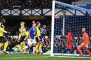 Arouna Kone of Everton (c) heads the ball and scores his teams 1st goal as Dagenham & Redbridge goalkeeper Mark Cousins () looks on. The Emirates FA cup, 3rd round match, Everton v Dagenham & Redbridge at Goodison Park in Liverpool on Saturday 9th January 2016.<br /> pic by Chris Stading, Andrew Orchard sports photography.