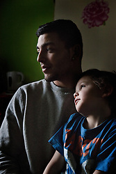 "Julius Mika is seen with his son of the same name, 5, in their home in Ostrava, Czech Republic on March 4, 2012. The elder Mika was one of 18 Roma children who were represented in the D.H. and Others v. Czech Republic case, the first challenge to systemic racial segregation in education to reach the European Court of Human Rights. When this case was first brought in 2000, Roma children in the Czech Republic were 27 times more likely to be placed in ""special schools,"" intended for the mentally disabled, than non-Roma children. In 2007, the Grand Chamber of the European Court of Human Rights ruled that this pattern of segregation violated nondiscrimination protections in the European Convention on Human Rights. Despite this landmark decision, little change has occurred: the ""special schools"" have been renamed but follow the same substandard curriculum and Roma continue to be assigned to these schools in disproportionate numbers. The process of integration has barely begun."