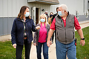 "14 OCTOBER 2020 - KNOXVILLE, IOWA: THERESA GREENFIELD, the Democratic candidate for US Senator from Iowa, (left) talks to SHARON SMITH and MAX SMITH at Smith Fertilizer and Grain. Greenfield toured Smith Fertilizer and Grain in Knoxville and talked to owner Max Smith about her ""Fair Shot for Our Farmers"" plan to improve Iowa's farm economy. Greenfield is in a tight race with incumbent Republican Senator Joni Ernst.       PHOTO BY JACK KURTZ"